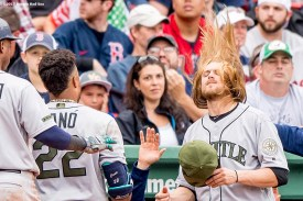 BOSTON, MA - MAY 28: Robinson Cano #22 of the Seattle Mariners reacts with Jean Segura #2 and Taylor Motter #21 after hitting a two run home run during the ninth inning of a game against the Boston Red Sox on May 28, 2017 at Fenway Park in Boston, Massachusetts. (Photo by Billie Weiss/Boston Red Sox/Getty Images) *** Local Caption *** Robinson Cano; Taylor Motter; Jean Segura