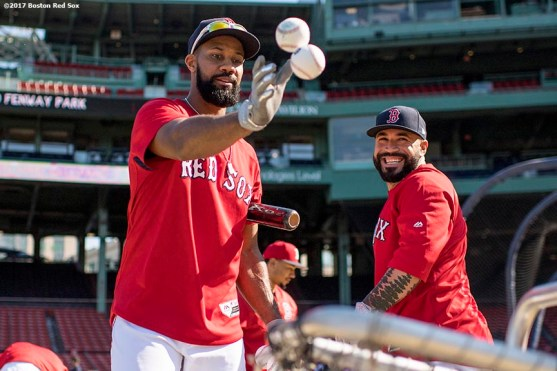 BOSTON, MA - JUNE 28: Chris Young #30 tosses balls into the basket as Sandy Leon #3 of the Boston Red Sox reacts before a game against the Minnesota Twins on June 28, 2017 at Fenway Park in Boston, Massachusetts. (Photo by Billie Weiss/Boston Red Sox/Getty Images) *** Local Caption ***Chris Young; Sandy Leon
