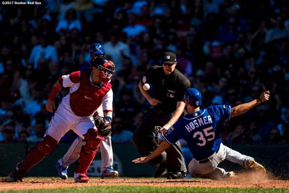 BOSTON, MA - JULY 30: Christian Vazquez #7 of the Boston Red Sox reaches for an overthrown ball as Eric Hosmer #35 of the Kansas City Royals slides to score during the eighth inning of a game on July 30, 2017 at Fenway Park in Boston, Massachusetts. (Photo by Billie Weiss/Boston Red Sox/Getty Images) *** Local Caption *** Christian Vazquez; Eric Hosmer