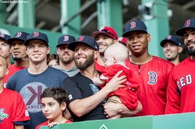 BOSTON, MA - AUGUST 16: Brock Holt #12, Dustin Pedroia #15, and Rafael Devers #11 of the Boston Red Sox pose for a photograph with a Jimmy Fund patient during the 2017 WEEI-NESN Jimmy Fund Radio-Telethon before a game against the St. Louis Cardinals on August 16, 2017 at Fenway Park in Boston, Massachusetts. (Photo by Billie Weiss/Boston Red Sox/Getty Images) *** Local Caption *** Dustin Pedroia; Rafael Devers; Brock Holt