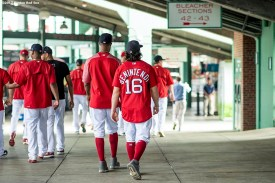 BOSTON, MA - AUGUST 16: Andrew Benintendi #16 walks through the concourse with members of the Boston Red Sox before a game against the St. Louis Cardinals on August 16, 2017 at Fenway Park in Boston, Massachusetts. (Photo by Billie Weiss/Boston Red Sox/Getty Images) *** Local Caption *** Andrew Benintendi