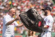 BOSTON, MA - AUGUST 20: Dustin Pedroia #15 of the Boston Red Sox presents NESN broadcaster Jerry Remy with a giant glove as a gift during a 30 year recognition ceremony before a game between the Boston Red Sox and the New York Yankees on August 20, 2017 at Fenway Park in Boston, Massachusetts. (Photo by Billie Weiss/Boston Red Sox/Getty Images) *** Local Caption *** Jerry Remy; Dustin Pedroia