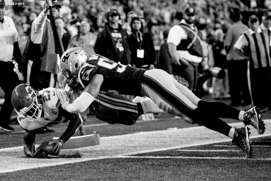 Kareem Hunt #27 of the Kansas City Chiefs dives for the pylon to score a go-ahead rushing touchdown during the opening game of the 2017 NFL season against the New England Patriots at Gillette Stadium in Foxborough, Mass. on Sept. 7, 2017. (Photo by Billie Weiss/The Players' Tribune)