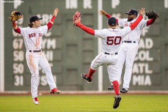 BOSTON, MA - SEPTEMBER 30: Mookie Betts #50, Andrew Benintendi #16,and Jackie Bradley Jr. #19 of the Boston Red Sox react after the final out was recorded to clinch the American League East Division against the Houston Astros on September 30, 2017 at Fenway Park in Boston, Massachusetts. (Photo by Billie Weiss/Boston Red Sox/Getty Images) *** Local Caption *** Mookie Betts; Andrew Benintendi; Jackie Bradley Jr.