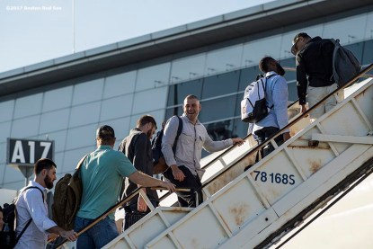 BOSTON, MA - OCTOBER 3: Members of the Boston Red Sox boards the plane to Houston before the American League Division Series against the Houston Astros on October 3, 2017 at Fenway Park in Boston, Massachusetts. (Photo by Billie Weiss/Boston Red Sox/Getty Images) *** Local Caption ***