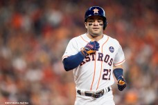 HOUSTON, TX - OCTOBER 5: Jose Altuve #27 of the Houston Astros reacts after hitting a solo home run during the first inning of game one of the American League Division Series against the Boston Red Sox on October 5, 2017 at Minute Maid Park in Houston, Texas. (Photo by Billie Weiss/Boston Red Sox/Getty Images) *** Local Caption *** Jose Altuve