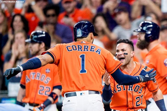 HOUSTON, TX - OCTOBER 6: Carlos Correa #1 of the Houston Astros reacts with Jose Altuve #27 after hitting a two run home run during the first inning of game two of the American League Division Series against the Boston Red Sox on October 6, 2017 at Minute Maid Park in Houston, Texas. (Photo by Billie Weiss/Boston Red Sox/Getty Images) *** Local Caption *** Carlos Correa; Jose Altuve