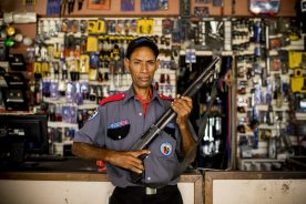 """""""A security guard poses for a portrait at the hardware store ferreteria in San Isidro during the 2017 Lindos Sueños trip in the Dominican Republic Thursday, July 20, 2017."""""""