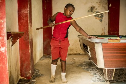 July 22, 2017, El Mamon, Dominican Republic: A local boy plays billiards in El Mamón during the 2017 Lindos Sueños trip in the Dominican Republic Saturday, July 22, 2017. (Photo by Billie Weiss/Boston Red Sox)