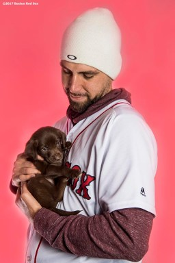 December 13, 2017, Roxbury, MA: Boston Red Sox pitcher Matt Barnes poses for a portrait with a puppy from the Great Dog Rescue of New England during The Gift Of Sox at Fenway Park in Boston, Massachusetts Wednesday, December 13, 2017. (Photo by Billie Weiss/Boston Red Sox)