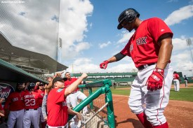 FORT MYERS, FL - FEBRUARY 23: Xander Bogaerts #2 of the Boston Red Sox high fives teammates after scoring during a game against the Minnesota Twins at JetBlue Park at Fenway South on February 23, 2018 in Fort Myers, Florida. (Photo by Billie Weiss/Boston Red Sox/Getty Images) *** Local Caption *** Xander Bogaerts