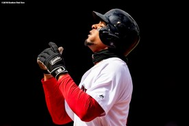 BOSTON, MA - APRIL 8: Xander Bogaerts #2 of the Boston Red Sox reacts after hitting a single during the second inning of a game against the Tampa Bay Rays on April 8, 2018 at Fenway Park in Boston, Massachusetts. (Photo by Billie Weiss/Boston Red Sox/Getty Images) *** Local Caption *** Xander Bogaerts