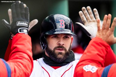 BOSTON, MA - APRIL 8: Mitch Moreland #18 of the Boston Red Sox high fives teammates after scoring during the eighth inning of a game against the Tampa Bay Rays on April 8, 2018 at Fenway Park in Boston, Massachusetts. (Photo by Billie Weiss/Boston Red Sox/Getty Images) *** Local Caption *** Mitch Moreland