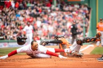 BOSTON, MA - APRIL 14: Mookie Betts #50 slides as he evades the tag of Chance Sisco #15 of the Baltimore Orioles to score during the first inning of a game against the Baltimore Orioles on April 14, 2018 at Fenway Park in Boston, Massachusetts. (Photo by Billie Weiss/Boston Red Sox/Getty Images) *** Local Caption *** Mookie Betts #50; Chance Sisco