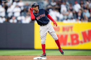 NEW YORK, NY - MAY 10: Mookie Betts #50 of the Boston Red Sox reacts after hitting a double during the first inning of a game against the New York Yankees on May 10, 2018 at Yankee Stadium in the Bronx borough of New York City. (Photo by Billie Weiss/Boston Red Sox/Getty Images) *** Local Caption *** Mookie Betts