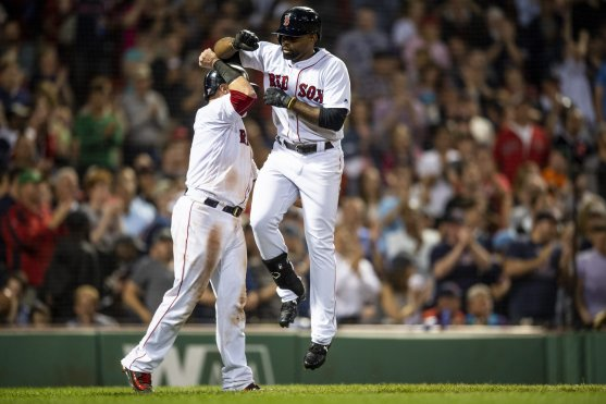 BOSTON, MA - JUNE 28: Jackie Bradley Jr. #19 of the Boston Red Sox high fives Christian Vazquez #7 after hitting a two run home run during the seventh inning of a game against the Los Angeles Angels of Anaheim on June 28, 2018 at Fenway Park in Boston, Massachusetts. (Photo by Billie Weiss/Boston Red Sox/Getty Images) *** Local Caption *** Jackie Bradley Jr.; Christian Vazquez
