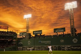 BOSTON, MA - JUNE 28: Mookie Betts #50 of the Boston Red Sox warms up as the sun sets during the fifth inning of a game against the Los Angeles Angels of Anaheim on June 28, 2018 at Fenway Park in Boston, Massachusetts. (Photo by Billie Weiss/Boston Red Sox/Getty Images) *** Local Caption *** Mookie Betts