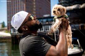 BOSTON, MA - AUGUST 2: Former designated hitter David Ortiz #34 of the Boston Red Sox plays with a dog as he boards a boat during a visit to Camp harbor View on August 2, 2018 in Boston, Massachusetts. (Photo by Billie Weiss/Boston Red Sox/Getty Images) *** Local Caption *** David Ortiz