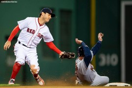 BOSTON, MA - SEPTEMBER 9: Ian Kinsler #5 of the Boston Red Sox tags out Brian McCann #16 of the Houston Astros as he attempts to steal second base during the fifth inning of a game on September 9, 2018 at Fenway Park in Boston, Massachusetts. (Photo by Billie Weiss/Boston Red Sox/Getty Images) *** Local Caption *** Ian Kinsler; Brian McCann