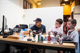 BOSTON, MA - SEPTEMBER 15: Manager Alex Cora of the Boston Red Sox spends time in his office with Shriners Hospital patient Sam Halpern and brother Ben before a game against the New York Mets on September 15, 2018 at Fenway Park in Boston, Massachusetts. (Photo by Billie Weiss/Boston Red Sox/Getty Images) *** Local Caption *** Alex Cora; Sam Halpern
