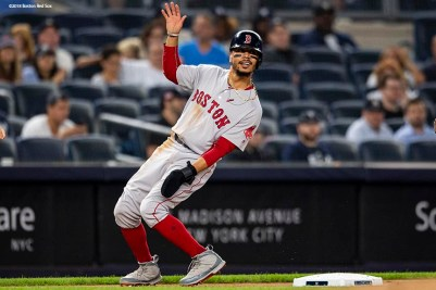 NEW YORK, NY - SEPTEMBER 19: Mookie Betts #50 of the Boston Red Sox reacts as he rounds first base during the first inning of a game against the New York Yankees on September 19, 2018 at Yankee Stadium in the Bronx borough of New York City. (Photo by Billie Weiss/Boston Red Sox/Getty Images) *** Local Caption *** Mookie Betts