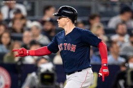 NEW YORK, NY - SEPTEMBER 20: Brock Holt #12 of the Boston Red Sox reacts after hitting a solo home run during the third inning of a game against the New York Yankees on September 20, 2018 at Yankee Stadium in the Bronx borough of New York City. (Photo by Billie Weiss/Boston Red Sox/Getty Images) *** Local Caption *** Brock Holt