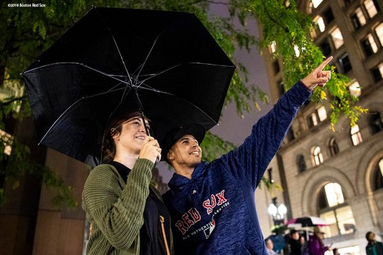 BOSTON, MA - OCTOBER 2: Spectators look on as image of the Boston Red Sox are projected onto the Old State House on October 2, 2018 in Boston, Massachusetts. (Photo by Billie Weiss/Boston Red Sox/Getty Images) *** Local Caption ***