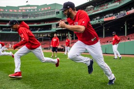 BOSTON, MA - OCTOBER 3: Mookie Betts #50 and J.D. Martinez #28 of the Boston Red Sox run sprints during a workout before the American League Division Series on October 3, 2018 at Fenway Park in Boston, Massachusetts. (Photo by Billie Weiss/Boston Red Sox/Getty Images) *** Local Caption *** Mookie Betts; J.D. Martinez