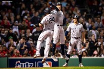 BOSTON, MA - OCTOBER 6: Gary Sanchez #24 of the New York Yankees reacts with Aaron Judge #99 and Giancarlo Stanton #27 after hitting a three run home run during the seventh inning of game two of the American League Division Series against the Boston Red Sox on October 6, 2018 at Fenway Park in Boston, Massachusetts. (Photo by Billie Weiss/Boston Red Sox/Getty Images) *** Local Caption *** Gary Sanchez; Aaron Judge; Giancarlo Stanton