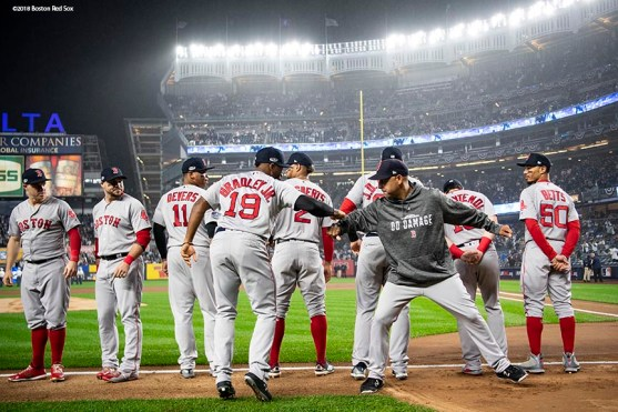 NEW YORK, NY - OCTOBER 8: Manager Alex Cora of the Boston Red Sox high fives Jackie Bradley Jr. #19 before game three of the American League Division Series against the New York Yankees on October 8, 2018 at Yankee Stadium in the Bronx borough of New York City. (Photo by Billie Weiss/Boston Red Sox/Getty Images) *** Local Caption *** Jackie Bradley Jr.; Alex Cora