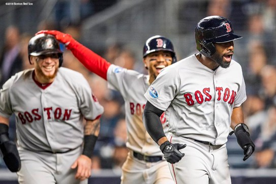 NEW YORK, NY - OCTOBER 8: Jackie Bradley Jr. #19, Christian Vazquez #7, and Mookie Betts #50 of the Boston Red Sox react after scoring during the fourth inning of game three of the American League Division Series against the New York Yankees on October 8, 2018 at Yankee Stadium in the Bronx borough of New York City. (Photo by Billie Weiss/Boston Red Sox/Getty Images) *** Local Caption *** Jackie Bradley Jr.; Christian Vazquez; Mookie Betts