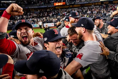 NEW YORK, NY - OCTOBER 9: Steve Pearce #25 and Andrew Benintendi #16 of the Boston Red Sox celebrate with teammates after clinching the American League Division Series in game four against the New York Yankees on October 9, 2018 at Yankee Stadium in the Bronx borough of New York City. (Photo by Billie Weiss/Boston Red Sox/Getty Images) *** Local Caption *** Steve Pearce; Andrew Benintendi