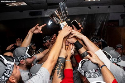 HOUSTON, TX - OCTOBER 18: Members of the Boston Red Sox celebrate with the American League Championship Series trophy in the clubhouse after clinching the American League Championship Series in game five against the Houston Astros on October 18, 2018 at Minute Maid Park in Houston, Texas. (Photo by Billie Weiss/Boston Red Sox/Getty Images) *** Local Caption ***