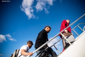 BOSTON, MA - OCTOBER 25: Rafael Devers #11, Xander Bogaerts #2, and Christian Vazquez #7 of the Boston Red Sox board the plane as they travel to Los Angeles before game three of the 2018 World Series against the Los Angeles Dodgers on October 25, 2018 at Fenway Park in Boston, Massachusetts. (Photo by Billie Weiss/Boston Red Sox/Getty Images) *** Local Caption *** Rafael Devers; Xander Bogaerts; Christian Vazquez