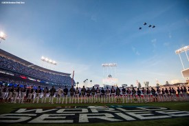 LOS ANGELES, CA - OCTOBER 26: A flyover is held as members of the Boston Red Sox line up during introductions before game three of the 2018 World Series against the Los Angeles Dodgers on October 26, 2018 at Dodger Stadium in Los Angeles, California. (Photo by Billie Weiss/Boston Red Sox/Getty Images) *** Local Caption ***
