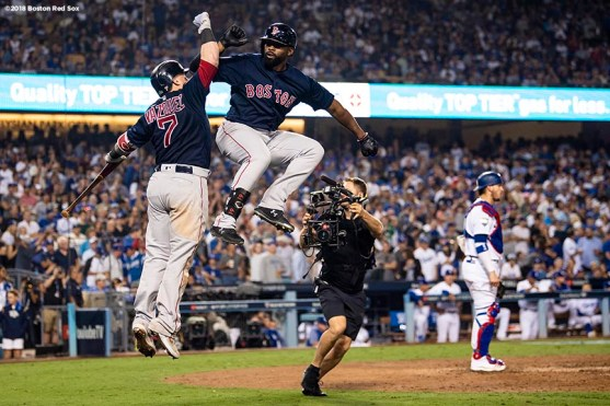 LOS ANGELES, CA - OCTOBER 26: Jackie Bradley Jr. #19 of the Boston Red Sox reacts with Christian Vazquez #7 after hitting a game tying solo home run during the eighth inning of game three of the 2018 World Series against the Los Angeles Dodgers on October 26, 2018 at Dodger Stadium in Los Angeles, California. (Photo by Billie Weiss/Boston Red Sox/Getty Images) *** Local Caption *** Jackie Bradley Jr.; Christian Vazquez