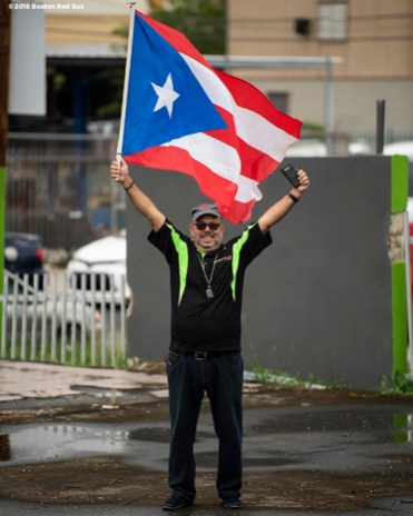 CAGUAS, PUERTO RICO - NOVEMBER 3: A fan displays a flag during a World Series parade during a Boston Red Sox trip from Boston, Massachusetts to Caguas, Puerto Rico on November 3, 2018 after the Boston Red Sox 2018 World Series victory. (Photo by Billie Weiss/Boston Red Sox/Getty Images) *** Local Caption ***