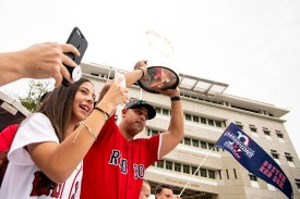 CAGUAS, PUERTO RICO - NOVEMBER 3: Manager Alex Cora of the Boston Red Sox displays the 2018 World Series trophy with his daughter Camila during a World Series parade during a Boston Red Sox trip from Boston, Massachusetts to Caguas, Puerto Rico on November 3, 2018 after the Boston Red Sox 2018 World Series victory. (Photo by Billie Weiss/Boston Red Sox/Getty Images) *** Local Caption *** Alex Cora