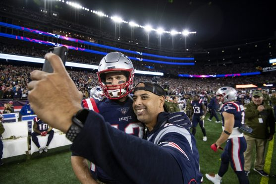 FOXBOROUGH, MA - NOVEMBER 4: Manager Alex Cora of the Boston Red Sox poses for a selfie photograph with Tom Brady #12 of the New England Patriots before a game against the Green Bay Packers on November 4, 2018 at Gillette Stadium in Foxborough, Massachusetts. (Photo by Billie Weiss/Boston Red Sox/Getty Images) *** Local Caption *** Alex Cora Tom Brady