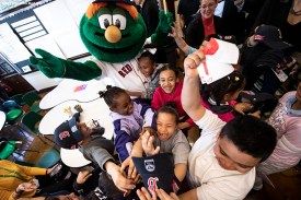 April 4, 2019 , Boston, MA: Boston Red Sox mascot Wally the Green Monster gives away hats to students during a visit to the Sarah Greenwood School in Dorchester, Massachusetts Thursday, April 4, 2019. (Photo by Billie Weiss/Boston Red Sox)
