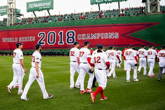 BOSTON, MA - APRIL 9: Members of the Boston Red Sox walk toward the outfield during a 2018 World Series championship ring ceremony before the Opening Day game against the Toronto Blue Jays on April 9, 2019 at Fenway Park in Boston, Massachusetts. (Photo by Billie Weiss/Boston Red Sox/Getty Images) *** Local Caption ***