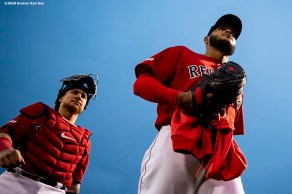 BOSTON, MA - APRIL 12: Christian Vazquez #7 and Eduardo Rodriguez #57 of the Boston Red Sox walk toward the dugout before a game against the Baltimore Orioles on April 12, 2019 at Fenway Park in Boston, Massachusetts. (Photo by Billie Weiss/Boston Red Sox/Getty Images) *** Local Caption *** Christian Vazquez; Eduardo Rodriguez