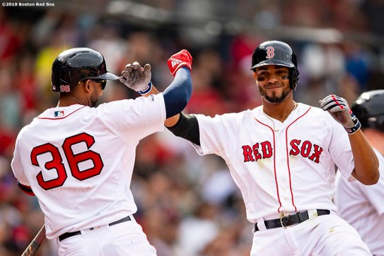 BOSTON, MA - APRIL 14: Xander Bogaerts #2 of the Boston Red Sox reacts with Eduardo Nunez #36 after hitting a three run home run during the eighth inning of a game against the Baltimore Orioles on April 14, 2019 at Fenway Park in Boston, Massachusetts. (Photo by Billie Weiss/Boston Red Sox/Getty Images) *** Local Caption *** Xander Bogaerts; DEduardo Nunez