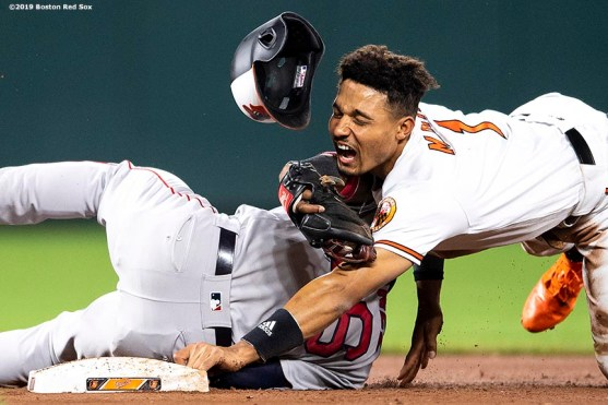 BALTIMORE, MD - MAY 8: Richie Martin #1 of the Baltimore Orioles reacts as he collides with Eduardo Nunez #36 of the Boston Red Sox as he steals second base during the eighth inning of a game on May 8, 2019 at Oriole Park at Camden Yards in Baltimore, Maryland. (Photo by Billie Weiss/Boston Red Sox/Getty Images) *** Local Caption *** Richie Martin; Eduardo Nunez