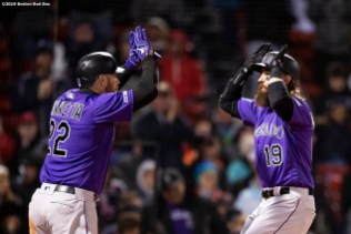 BOSTON, MA - MAY 14: Charlie Blackmon #19 of the Colorado Rockies reacts with Chris Iannetta #22 after hitting a go ahead two run home run during the eighth inning of a game against the Colorado Rockies on May 14, 2019 at Fenway Park in Boston, Massachusetts. (Photo by Billie Weiss/Boston Red Sox/Getty Images) *** Local Caption *** Charlie Blackmon; Chris Iannetta