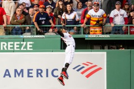 BOSTON, MA - MAY 18: Mookie Betts #50 of the Boston Red Sox attempts to catch a fly ball during the first inning of a game against the Houston Astros on May 18, 2019 at Fenway Park in Boston, Massachusetts. (Photo by Billie Weiss/Boston Red Sox/Getty Images) *** Local Caption *** Mookie Betts