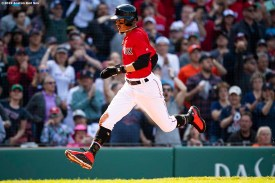 BOSTON, MA - MAY 19: Mookie Betts #50 of the Boston Red Sox scores the go ahead run during the seventh inning of a game against the Houston Astros on May 19, 2019 at Fenway Park in Boston, Massachusetts. (Photo by Billie Weiss/Boston Red Sox/Getty Images) *** Local Caption *** Mookie Betts