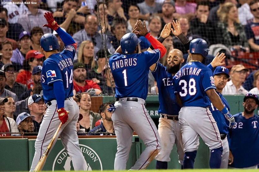 BOSTON, MA - JUNE 10: Elvis Andrus #1, Danny Santana #38, Asdrubal Cabrera #14 and Rougned Odor #12 of the Texas Rangers react after the go ahead run was scored during the ninth inning of a game against the Boston Red Sox on June 10, 2019 at Fenway Park in Boston, Massachusetts. (Photo by Billie Weiss/Boston Red Sox/Getty Images) *** Local Caption *** Rougned Odor; Elvis Andrus; Danny Santana; Asdrubal Cabrera