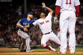 BOSTON, MA - JUNE 10: Xander Bogaerts #2 of the Boston Red Sox is tagged out by Logan Forsyth #41 of the Texas Rangers as he is caught in a run down during the ninth inning of a game against the Texas Rangers on June 10, 2019 at Fenway Park in Boston, Massachusetts. (Photo by Billie Weiss/Boston Red Sox/Getty Images) *** Local Caption *** Xander Bogaerts; Logan Forsyth