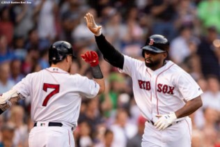 BOSTON, MA - JUNE 24: Jackie Bradley Jr. #19 of the Boston Red Sox high fives Christian Vazquez #7 after hitting a solo home run during the third inning of a game against the Chicago White Sox on June 24, 2019 at Fenway Park in Boston, Massachusetts. (Photo by Billie Weiss/Boston Red Sox/Getty Images) *** Local Caption *** Jackie Bradley Jr.; Christian Vazquez